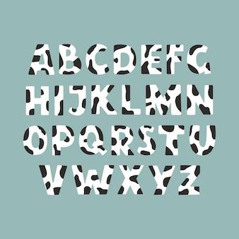 귀하의 디자인에 대 한 귀여운 암소 피부 알파벳 현대 만화 디자인 벡터 일러스트 레이 션