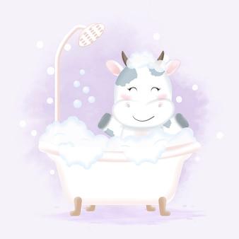 Cute cow taking bath in bathtub