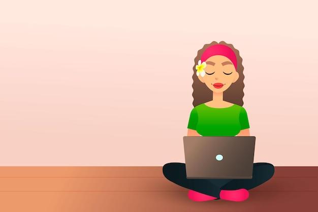 Симпатичная творческая девушка сидит на деревянном полу и учится с ноутбуком