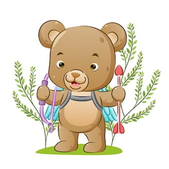 The cute cupid bear is holding the arrow standing in the park of illustration