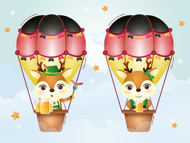 Cute deer on hot air balloon with traditional oktoberfest dress
