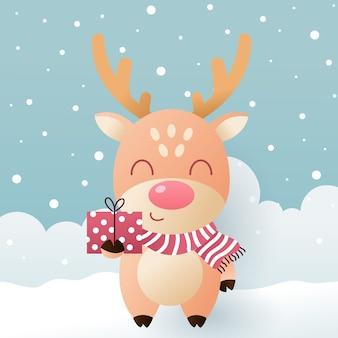 Милый олень в зимнем шарфе с подарочной коробкой и снегом.