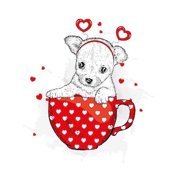 かわいい犬のカップとハートバレンタインデーは白で隔離