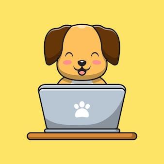 かわいい犬がラップトップで遊んでいます