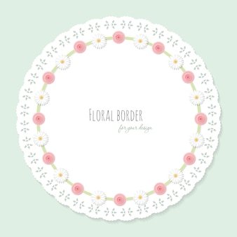 Cute doily frame decorated with flowers.