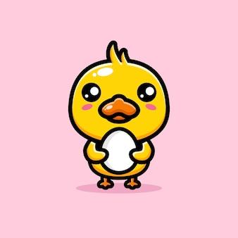 Милая утка обнимает утиное яйцо