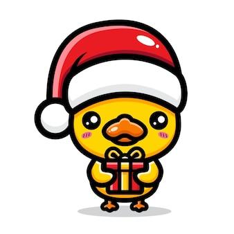 귀여운 오리가 크리스마스를 축하하고 있다