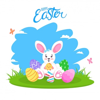 Cute easter bunny and colorful eggs on nature background. happy easter.