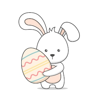 Cute easter bunny holding an egg