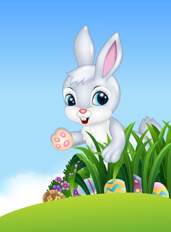 Cute easter bunny looking for colorful easter eggs