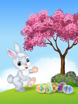Cute easter bunny walking with colourful easter eggs