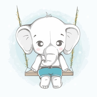Милый слоненок сидит на качелях