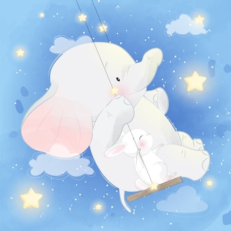 Cute elephant with bunny sitting on the swing