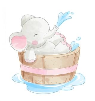 Cute elephant in wooden bathtub