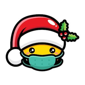 サンタの帽子とマスクを身に着けているかわいい絵文字