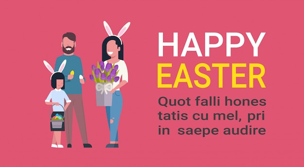 Cute family at happy easter holiday parents with kid holding flowers celebrate spring holiday on template