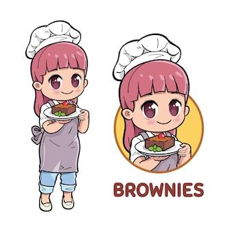 ブラウニーケーキを提示するかわいい女性シェフ