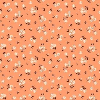かわいい花の背景明るいオレンジ色の背景に小さな花が付いたシームレスなベクトルパターン