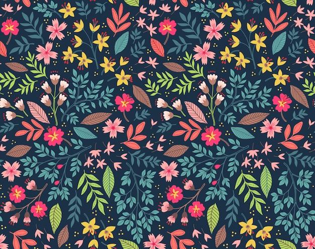 小さな色とりどりの花でかわいい花柄。シームレスなベクトルの背景。