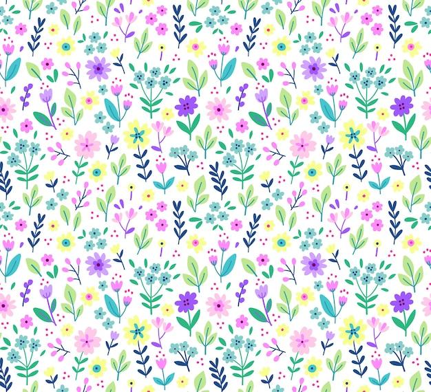 小さな花のかわいい花柄。ちっぽけなプリント。シームレスなテクスチャ。ファッションプリントのエレガントなテンプレート。小さなライラックの花で印刷。白色の背景。