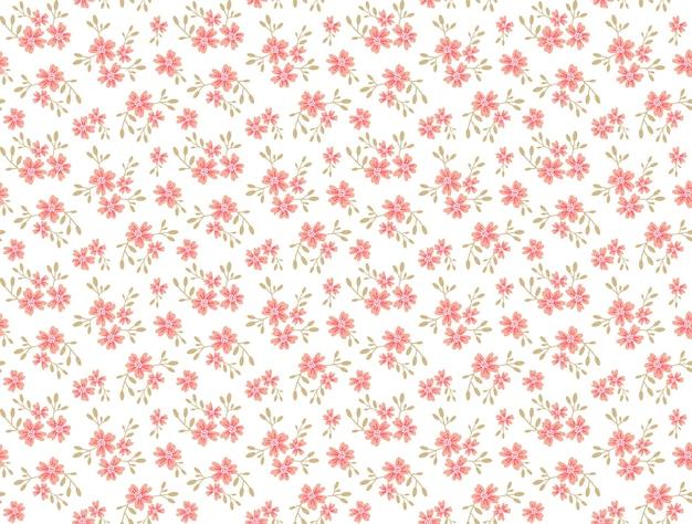 小さな花のかわいい花柄。ちっぽけなプリント。シームレスなテクスチャ。ファッションプリントのエレガントなテンプレート。小さなバラ色の花で印刷。白色の背景。
