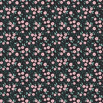 小さなピンクの花のかわいい花柄。シームレスなテクスチャ。黒の背景。