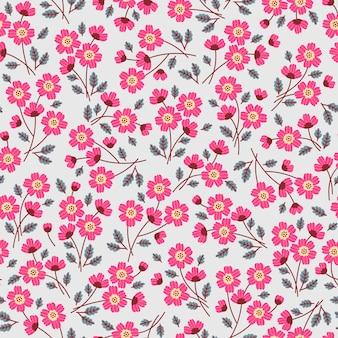 小さなピンクの花のかわいい花柄。シームレスなテクスチャ。淡い灰色の背景。