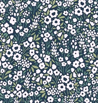 Симпатичный цветочный узор в маленькие белые цветы бесшовные векторные текстуры темно-синий фон
