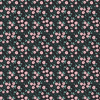 Cute floral pattern in the small pink flowers. seamless  texture. black background.
