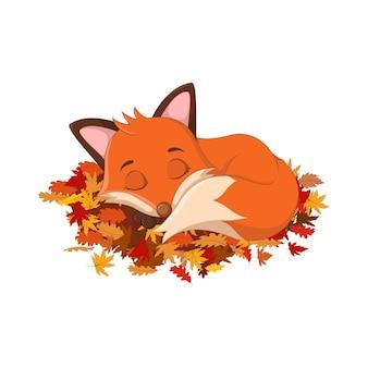 紅葉で眠っているかわいいキツネ