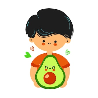 Cute funny boy hold avocado in hand