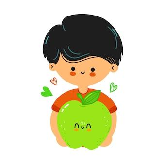 かわいい面白い男の子は手に青リンゴを持っています