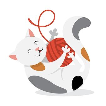 Милый забавный кот играет с игрушкой