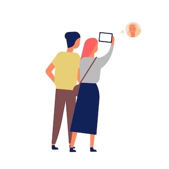 스마트 폰을 통해 친구와 귀여운 재미있는 커플 비디오 채팅. 화상 회의를 위해 휴대 전화를 사용하는 젊은 남녀