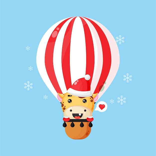 Cute giraffe in santa hat on a hot air balloon