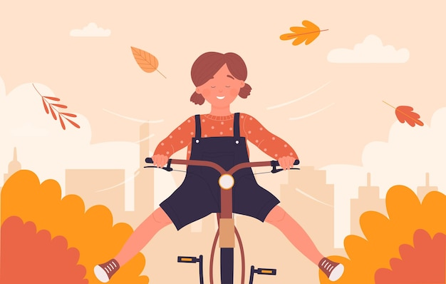 Cute girl child cyclist riding bike fast on city street road with fun autumn landscape