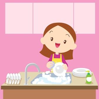 Cute girl dish washing