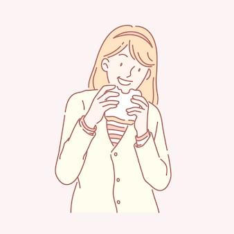 Милая девушка ест тост в желтом вязаном пальто в линейном стиле