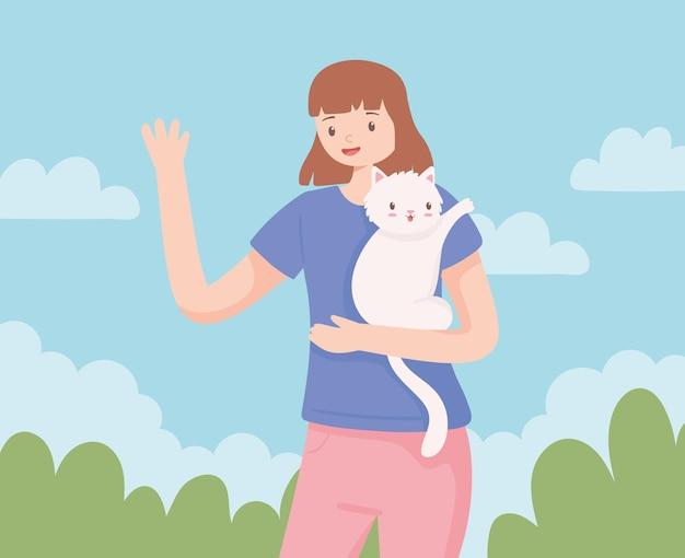 고양이를 안고 있는 귀여운 소녀