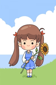 Cute girl holding sun flower on green field in spring time