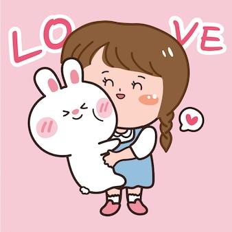 かわいい女の子は素敵なウサギを抱っこ