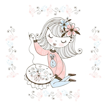 A cute girl is engaged in needlework and embroidery a beautiful pattern on a hoop.