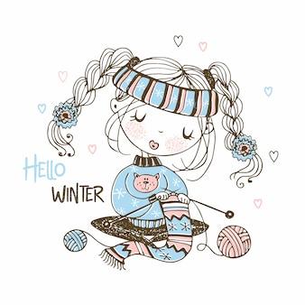 かわいい女の子はスカーフを編む冬の準備をしています。冬よ、こんにちは。