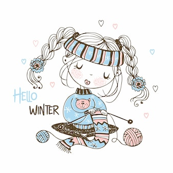 Cute girl is preparing for the winter knitting a scarf. hello winter.