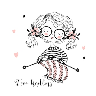 A cute girl knits a scarf on her knitting needles.