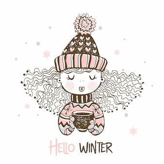 Cute girl in a knitted hat and mittens drinking hot coffee. hello winter.