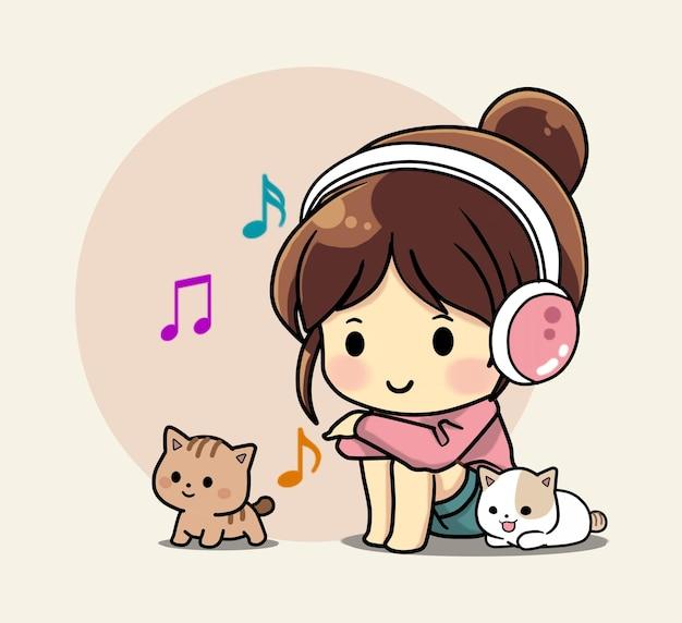 かわいい子猫と一緒に音楽を聴いているかわいい女の子