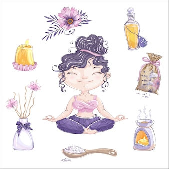 The cute girl meditates in a lotus position and a set of accessories for aromatherapy.