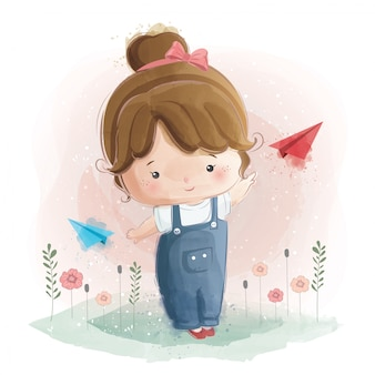 Cute girl playing with plane paper