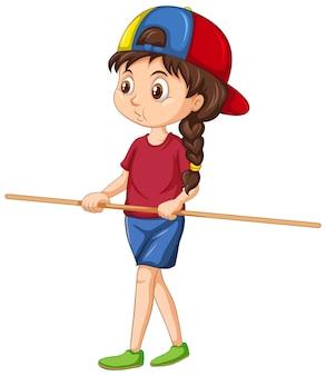 立って、木製の柄を持っているかわいい女の子